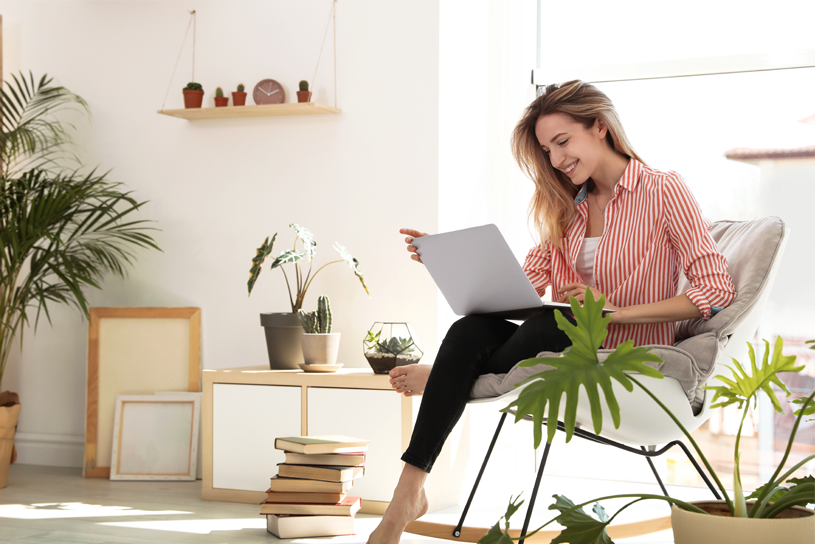 young woman on laptop in modern apartment